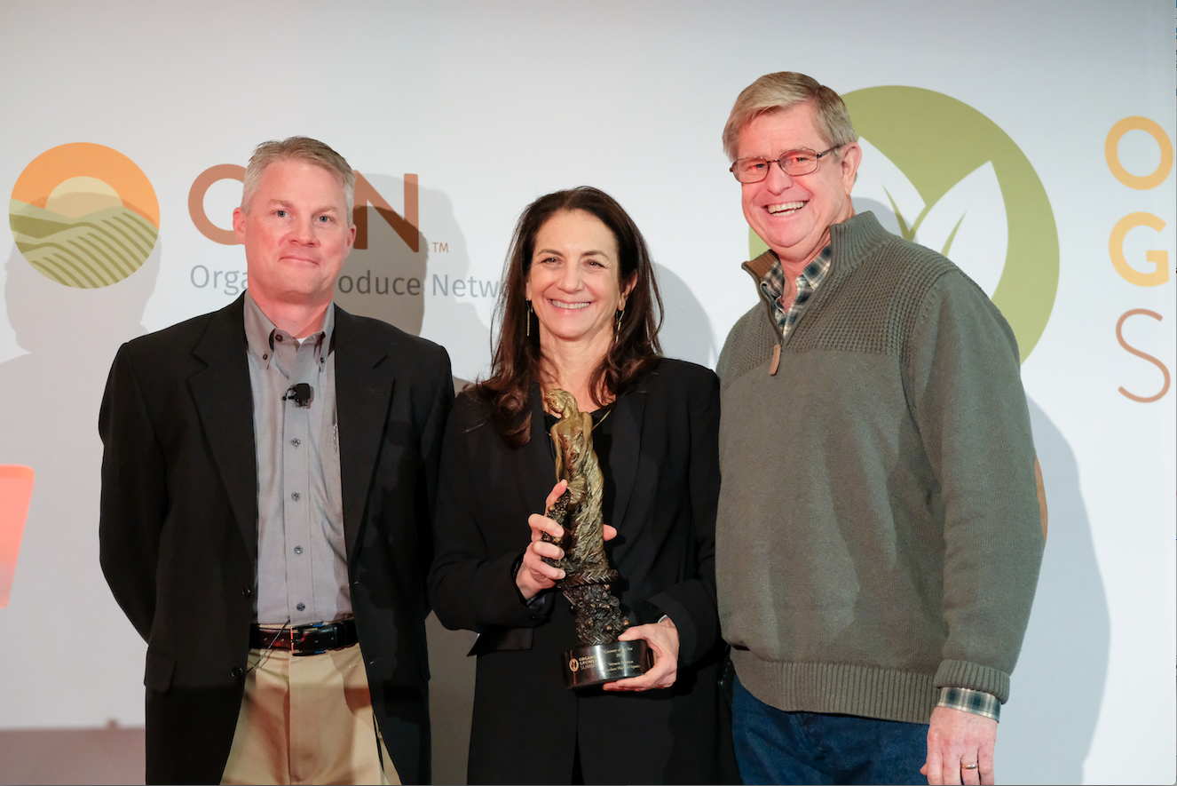 (from left to right) Greg Milstead - AGCO, Cathy Calfo - CCOF, Vernon Peterson - Grower of the Year, Peterson Family Farms, Abundant Harvest Organic